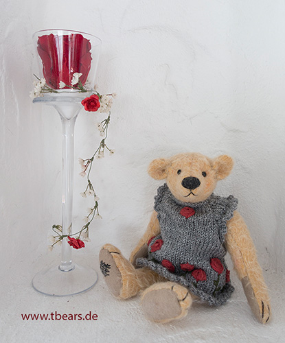 teddy bear with a rose dress